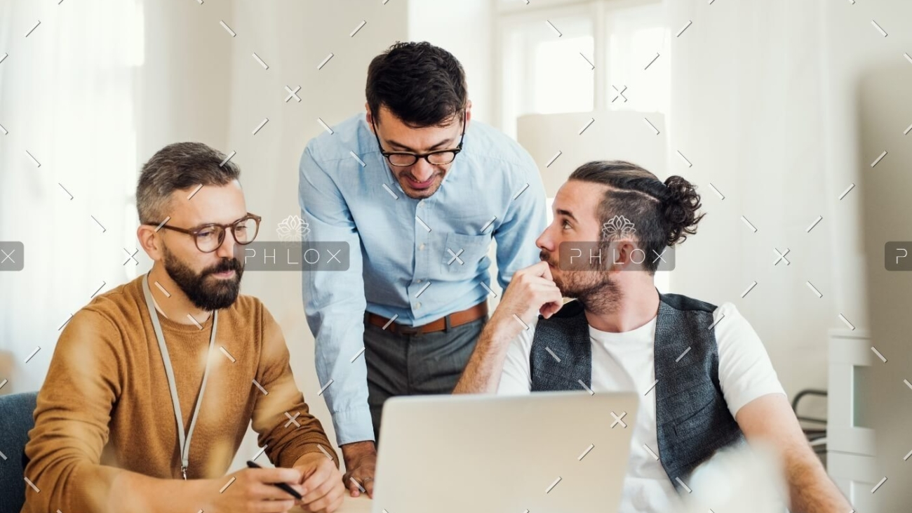 demo-attachment-500-group-of-young-businesspeople-with-laptop-working-8SHTZUN